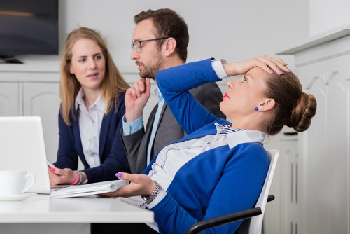 dissatisifed business woman in meeting difficult meeting difficult person.jpg